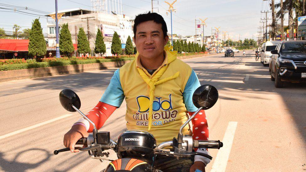 Sam Chareanphol on his motorbike