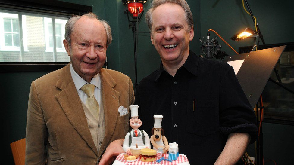 Peter Sallis and Nick Park with cake featuring Wallace and Gromit