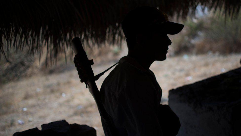 File image policeman at a checkpoint in Apaxtla de Castrejon, Guerrero state, Mexico, on March 26, 2018