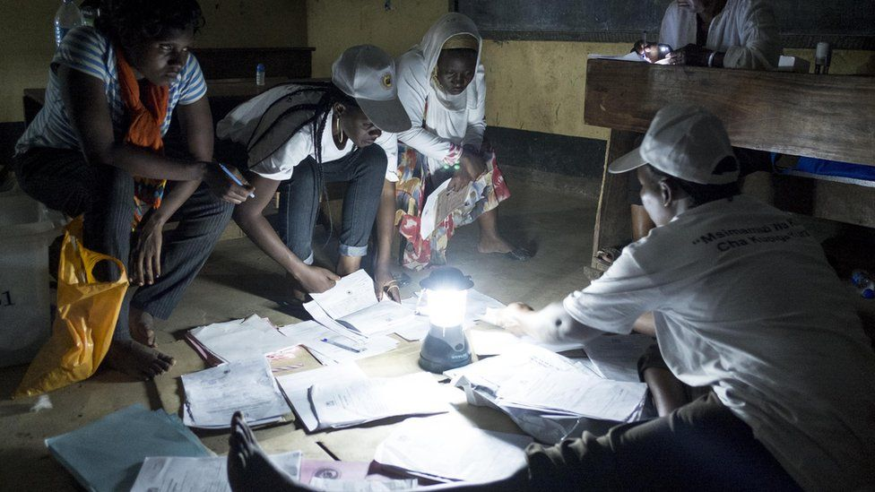 Election workers counting votes by torch lamp in Tanzania - October 2015
