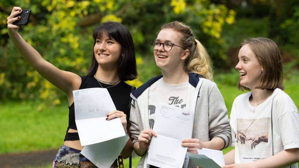 Students pose for a photograph with their A Level results at Ffynone House School in Swansea