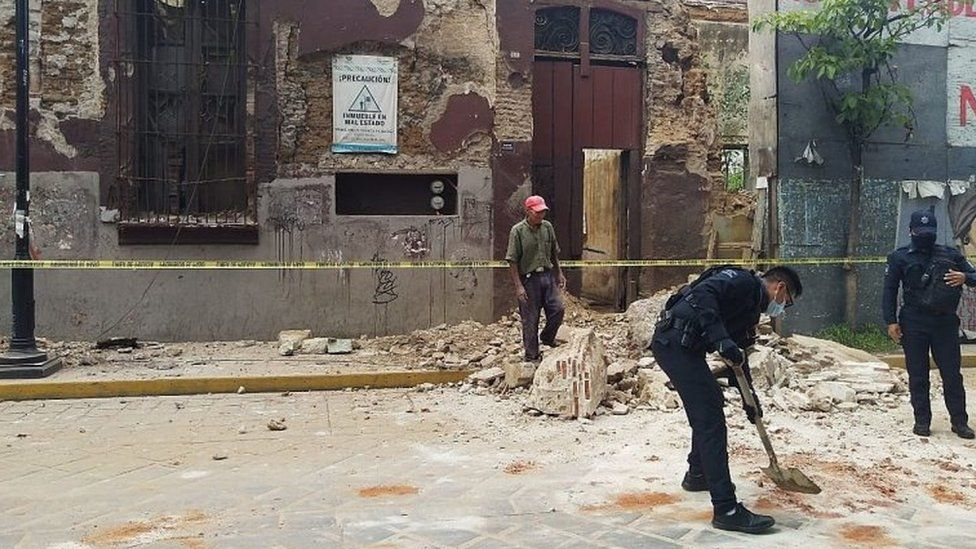 Authorities clear debris after an earthquake in Oaxaca, Mexico, 23 June 2020.