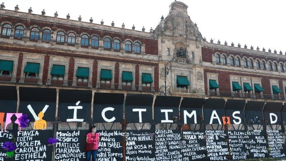 "A woman stands next to placards with names of women victims of violence as preparations to the Women""s International Day in Mexico City, Mexico, 07 March 2021"