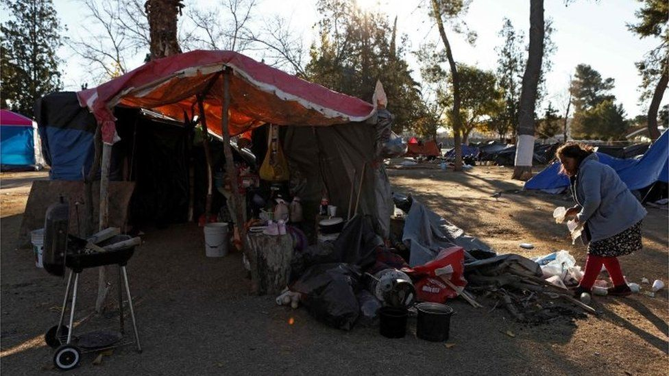 A family of Mexican migrants camps at a park while waiting to apply for asylum in the US in Ciudad Juarez