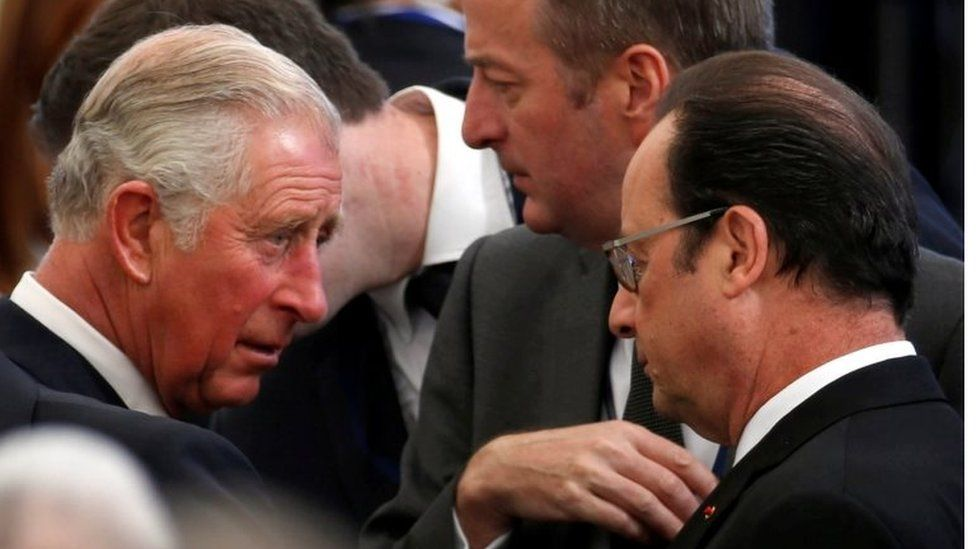 """Britain""""s Prince Charles (L) and French President Francois Hollande (R) are seen upon their arrival to attend the funeral of former Israeli President Shimon Peres at Mount Herzl cemetery in Jerusalem on 30 September 2016."""