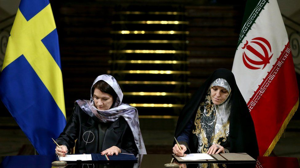 """Sweden""""s Minister for EU Affairs and Trade Ann Linde, left, and Iran""""s Vice President for Women and Family Affairs Shahindokht Molaverdi signing documents at the Saadabad Palace in Tehran, Iran, Saturday, Feb. 11, 2017"""