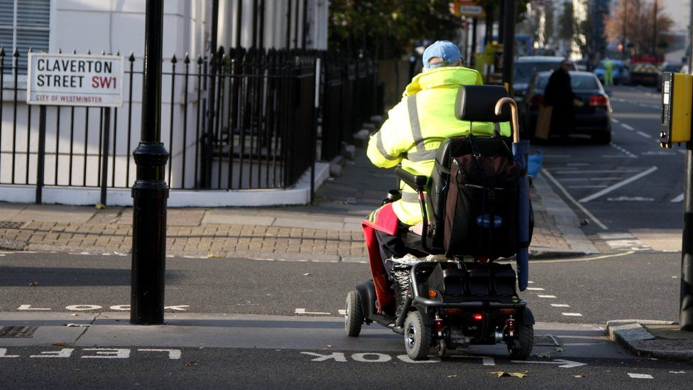 Man using mobility scooter