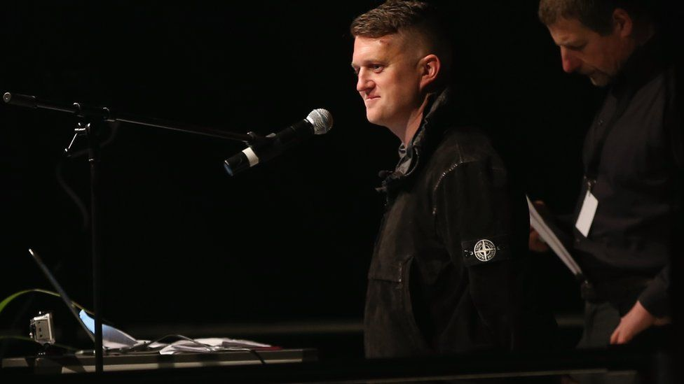 Tommy Robinson of the English Defense League speaks to supporters of the Pegida movement gathered on the first anniversary since the first Pegida march on October 19, 2015 in Dresden, Germany