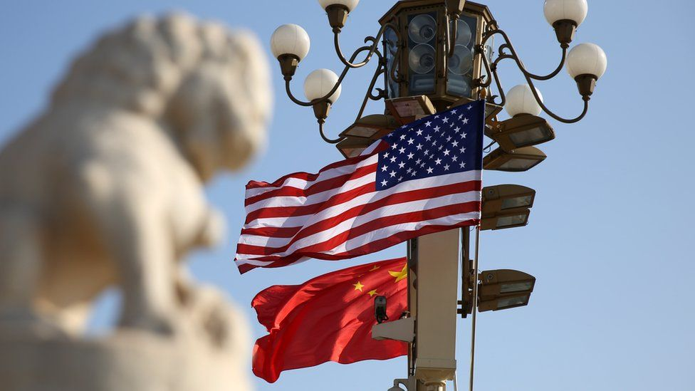 Chinese and American national flags fly on Tiananmen Square