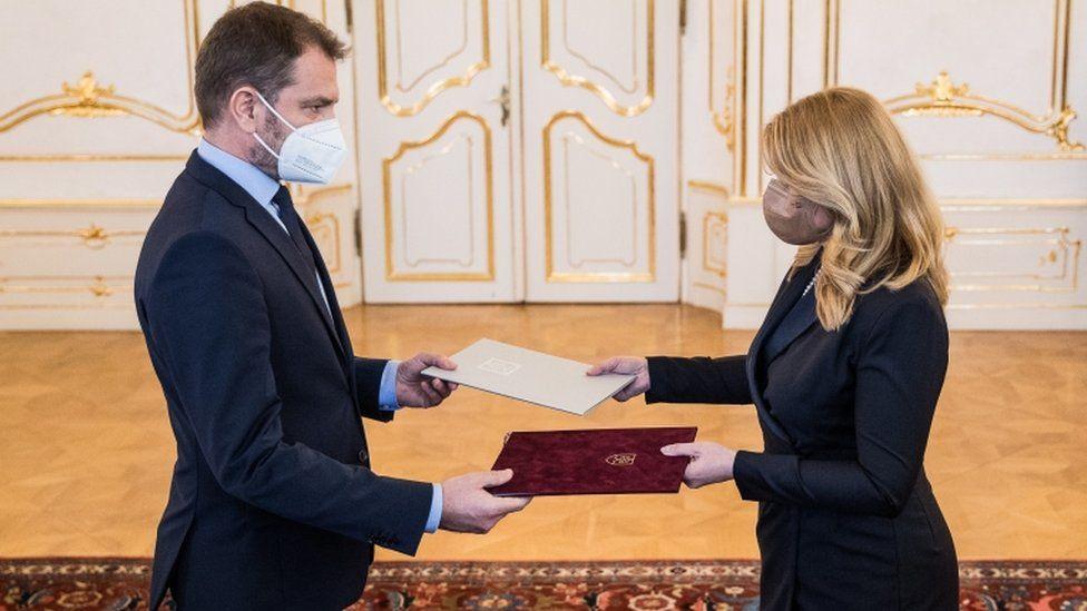 Slovak Prime Minister Igor Matovic (L) delivers his resignation to the President of the Slovakia Zuzana Caputova (R) in Bratislava, Slovakia, 30 March 2021