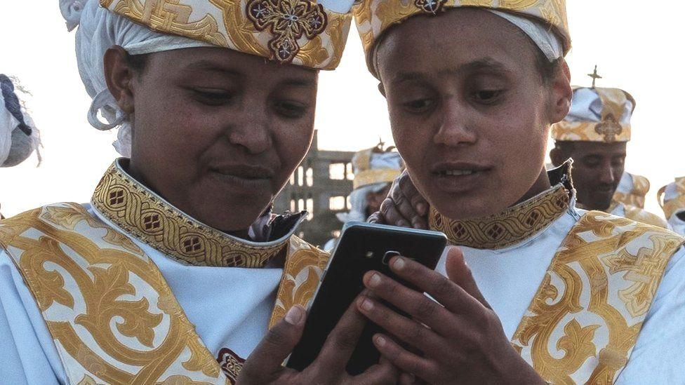 Orthodox Ethiopians using smart phones in Addis Ababa - January 2019