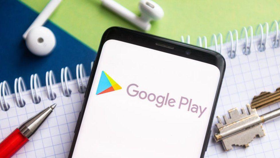 Google Play logo in phone