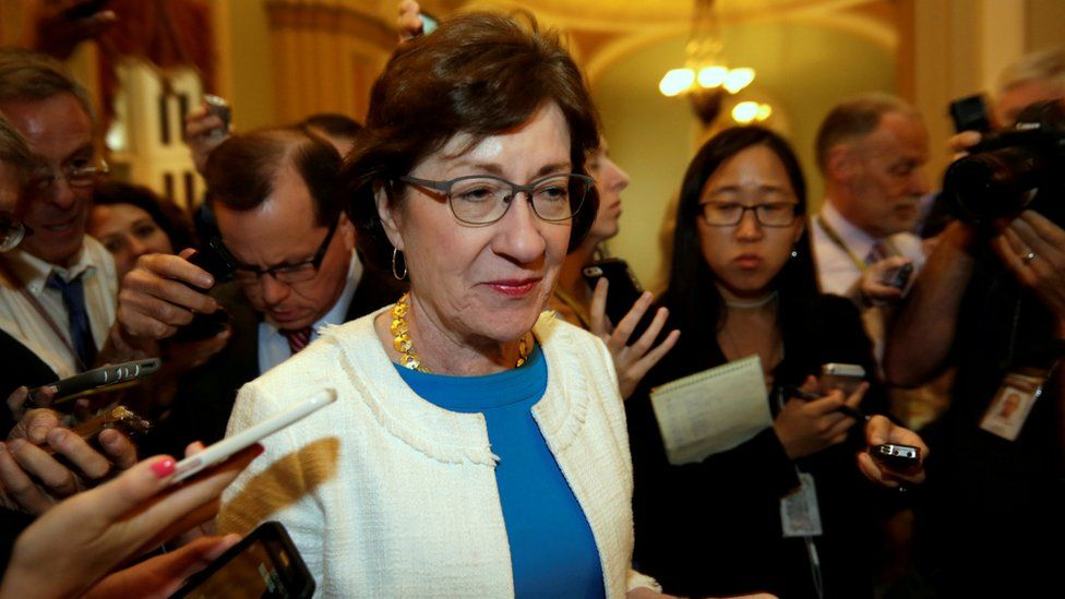 US Senator Susan Collins talks to reporters as she arrives for a Senate healthcare vote on Capitol Hill