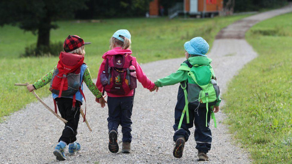 Children walking to a Bavarian forest kindergarten, file pic, 31 Jul 17