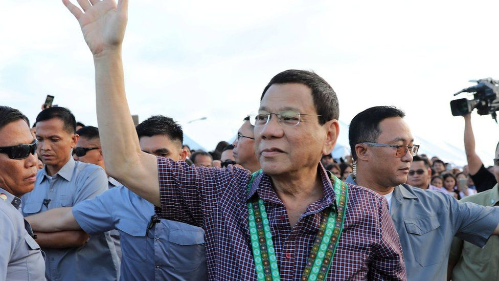 Duterte greets supporters during an airport inspection in Cagayan province