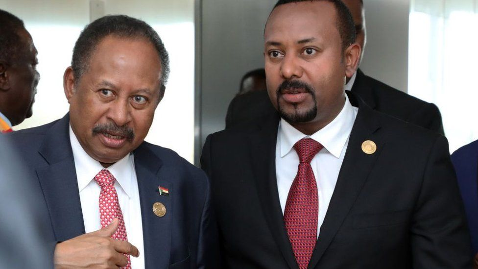 Prime Minister of Ethiopia Abiy Ahmed (R) and Prime minister of Sudan Abdalla Hamdok (L) attend the opening session of the 33rd African Union Heads of State Summit in Addis Ababa, Ethiopia on February 09, 2020.
