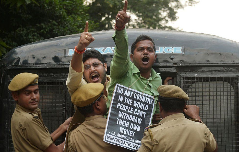 Indian police arrest a Congress activist shouting slogans against prime minister Narendra Modi during a protest march against the current demonetisation, in Kolkata on December 1, 2016. The activists were protesting against India's controversial ban on high-value banknotes, which opposition party organisers say has caused a 'financial emergency'.