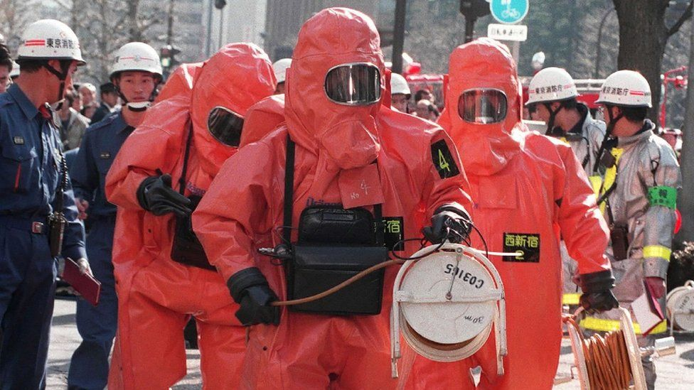 Police in hazmat suits at the site of the 1995 attack