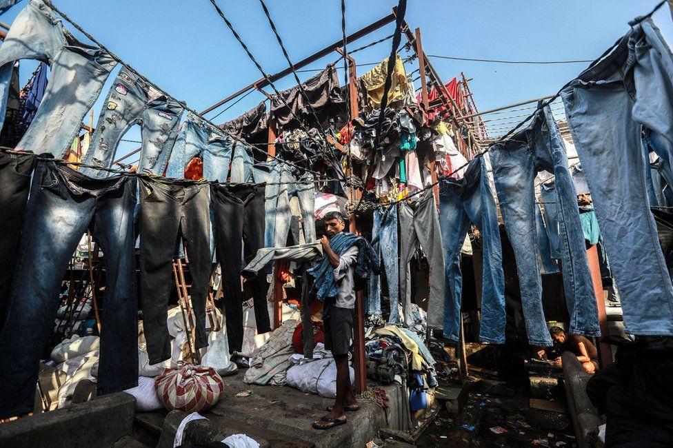 A dhobi hangs out washed clothes at the Mahalaxmi Dhobi Ghat in Mumbai, India