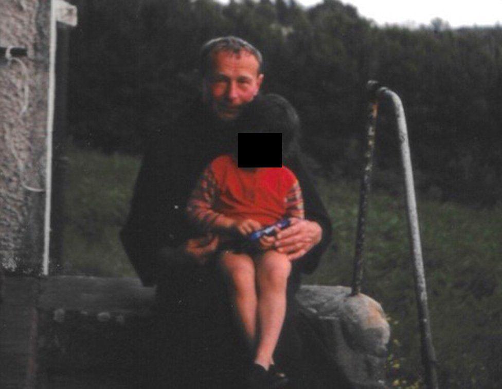 Thaddeus Kotik with child