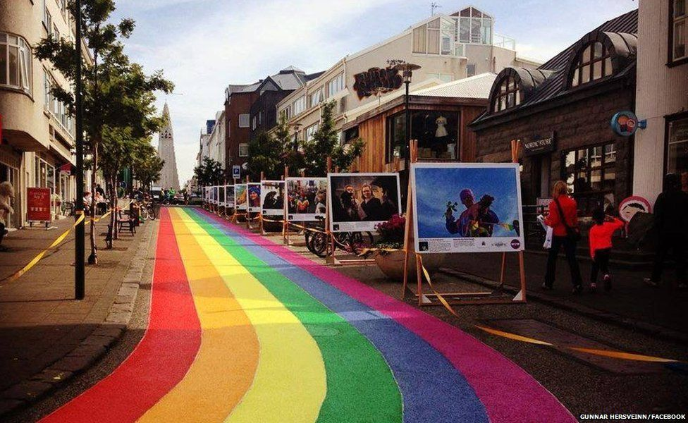 A view of the street painted in rainbow colours