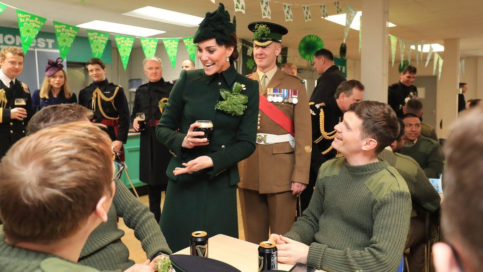 The Duchess of Cambridge at the St Patrick's Day parade at Cavalry Barracks in Hounslow, where she presented shamrock to officers and guardsmen of 1st Battalion the Irish Guards
