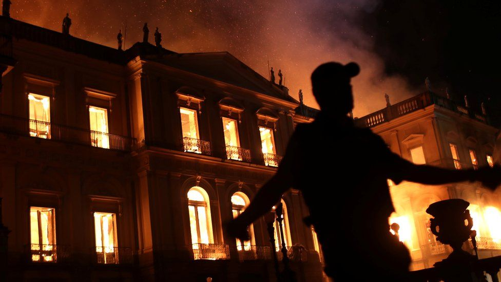 A policeman clears the area during a fire at the National Museum of Brazil in Rio de Janeiro, Brazil on 2 September2018.