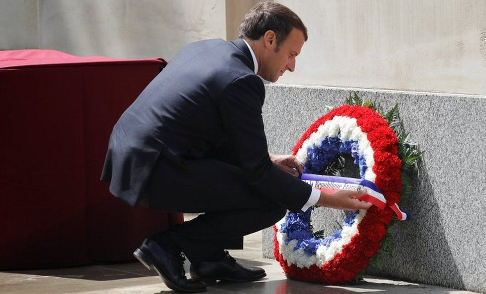Emmanuel Macron lays a wreath at the statue of Queen Elizabeth, the Queen Mother