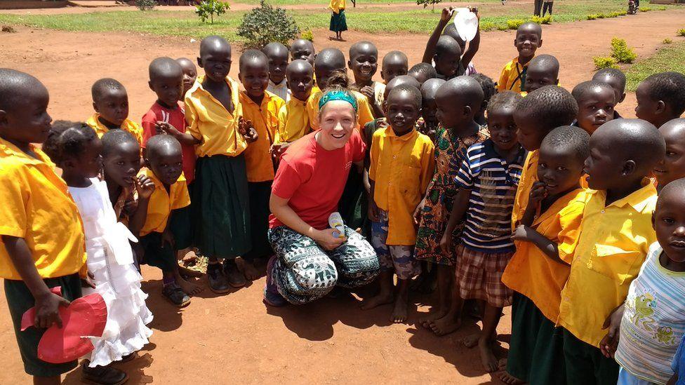 Bethany Barr with school children in Uganda
