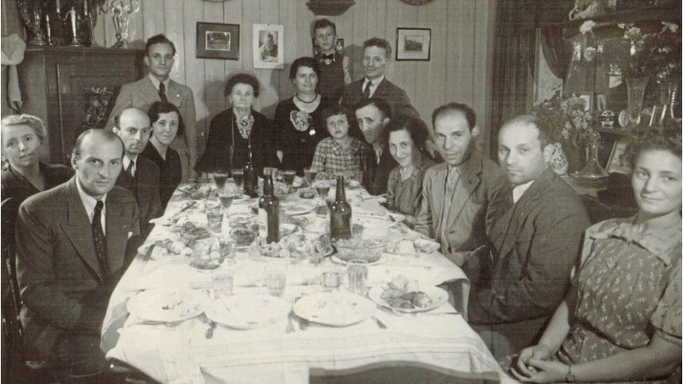 Elsie's sister Esther (fourth from right), who died at Auschwitz, attending a dinner with Jewish friends in June 1942. Only five people in this group survived the Holocaust