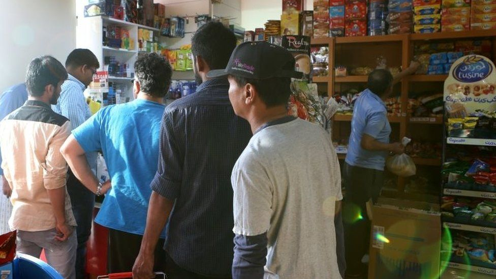 People buy snacks at a shop in Doha, on 5 June 2017.