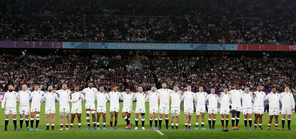 The England starting players and replacements singing the national anthem before the semi-final against New Zealand