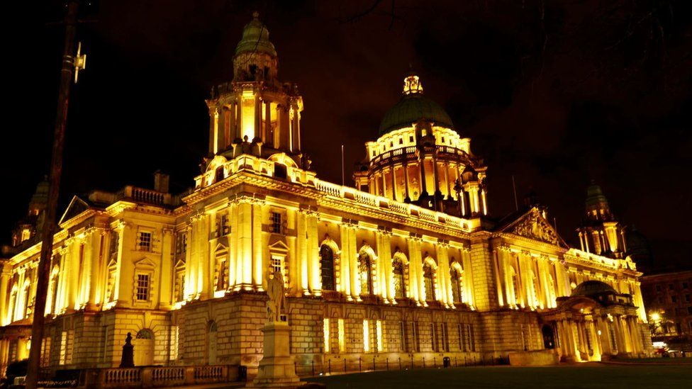 Belfast City Hall lit up in remembrance for those who have died during the Covid-19 pandemic