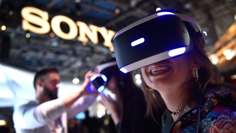 Woman wears virtual reality headset at Consumer Electtronics Show in Las Vegas