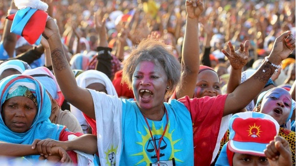 A supporter of former Tanzania's Prime Minister Edward Lowassa cheers during his campaign rally in Tanga October 21, 2015