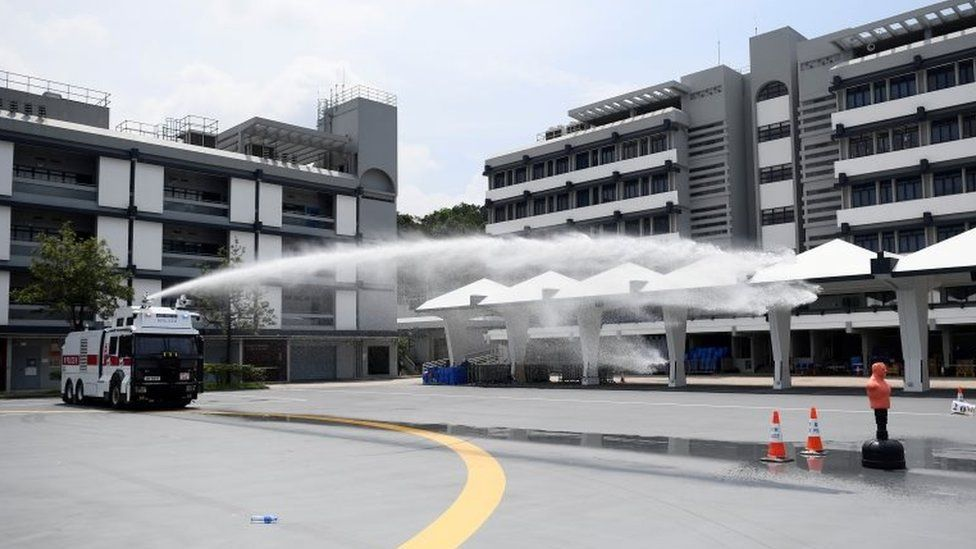 Hong Kong Police demonstrate their new water cannon equipped vehicle at the Police Tactical Unit compound in Hong Kong