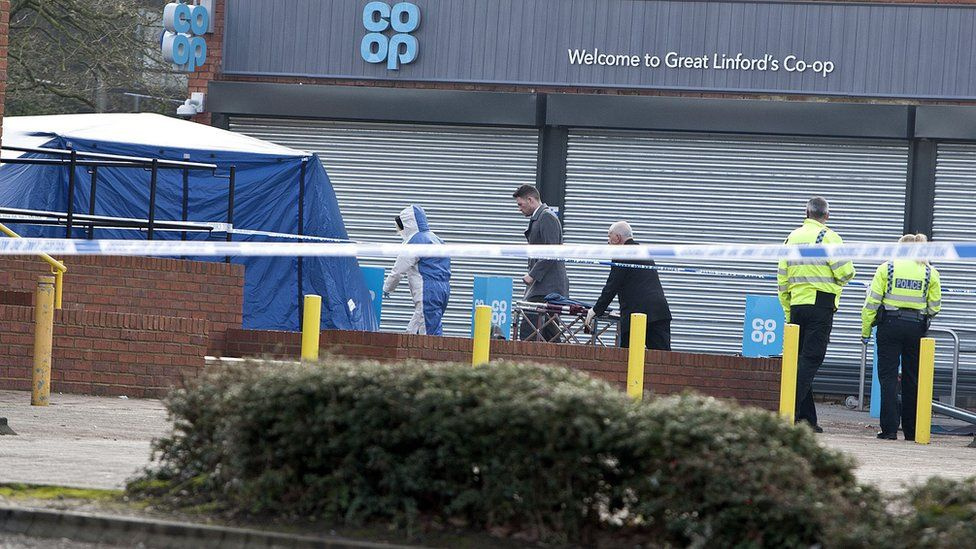 Police and forensics at the death scene near the Co-Op at Great Linford