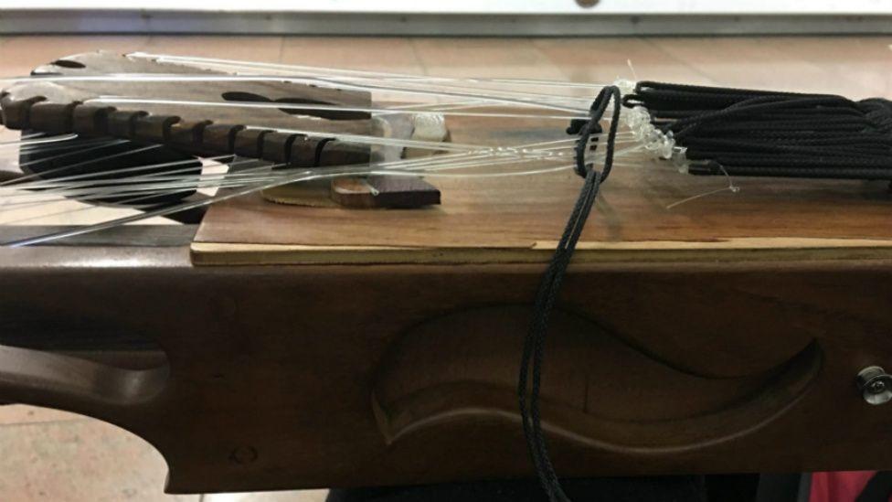 The broken bridge of N'Faly Kouyate's instrument.