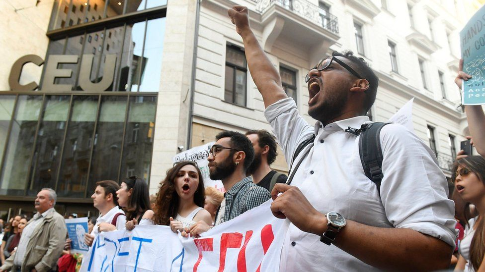 A protester raises his fist outside the CEU university