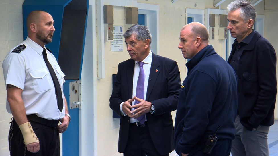 Alan Smith and David Dein with prison staff