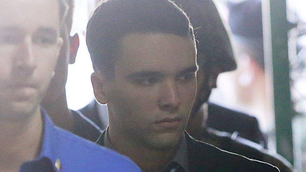 U.S. Marine Lance Corporal Joseph Scott Pemberton (R) is escorted into a court in Olongapo city, north of Manila December 1, 2015