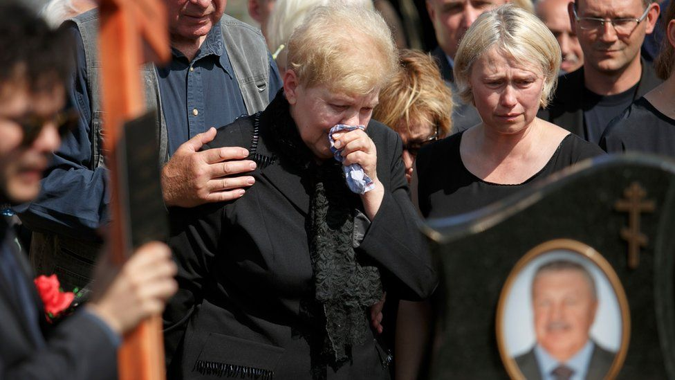 Mother of killed journalist Pavel Sheremet and his partner Olena Prytula, right, cry during his funeral at a cemetery in Minsk, Belarus, Saturday,23 July 2016.