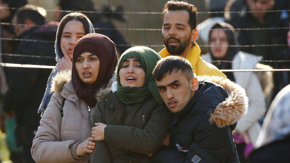 Migrants walk towards Greek border