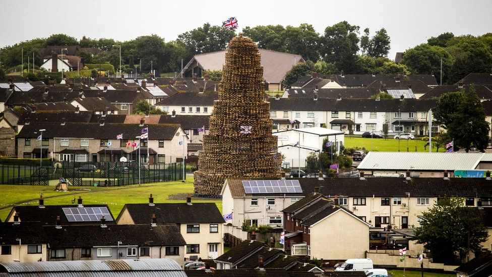A bonfire towers over houses in the Craigyhill estate in Larne