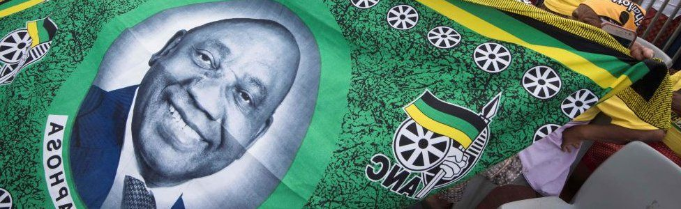 A cloth being held by African National Congress (ANC) supporters showing the face of South African President and ANC President Cyril Ramaphosa t