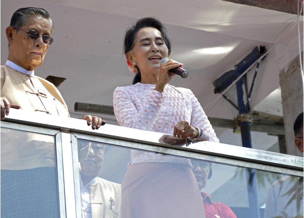 Myanmar's opposition leader Aung San Suu Kyi delivers a speech next to party patron Tin Oo, left, in Yangon, Myanmar, Monday, 9 November 2015