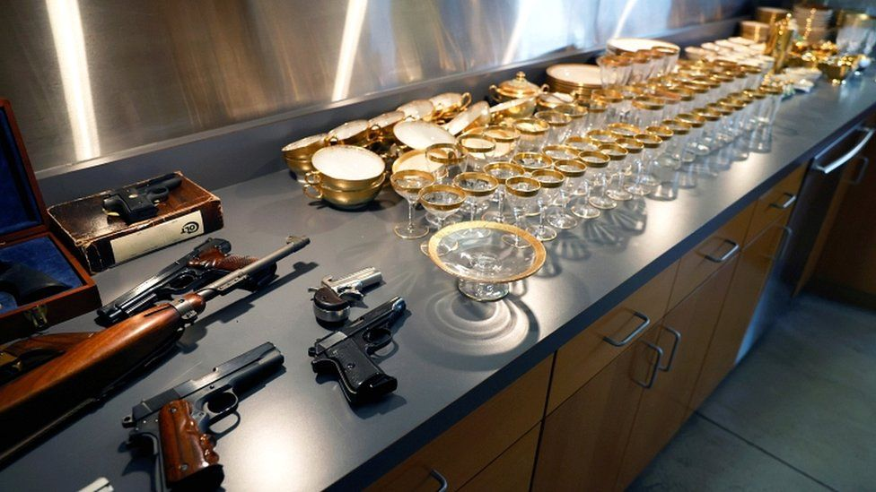 Guns and glassware that belonged to American gangster Al Capone and his son Sonny are displayed ahead of an auction in Sacramento, California, on 5, October 2021.