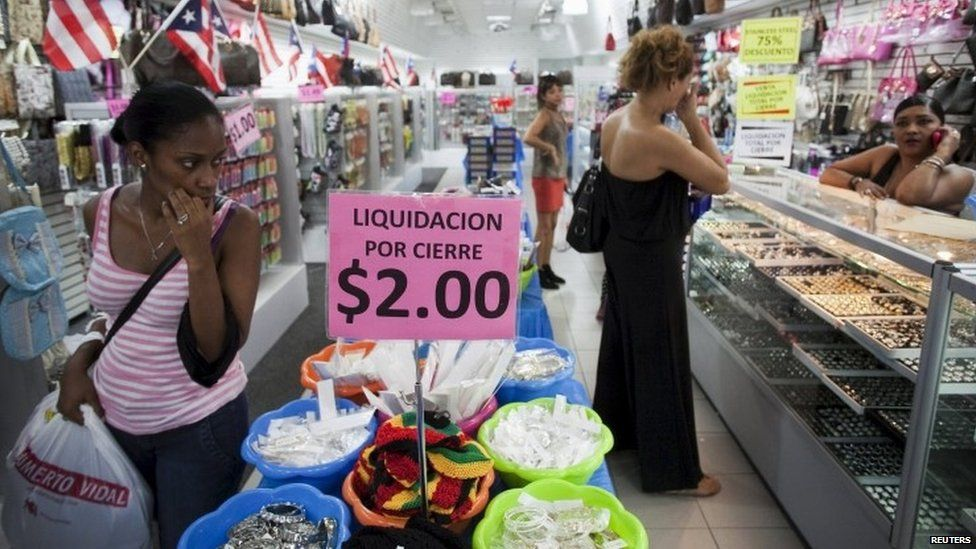 People shop in a store in San Juan, Puerto Rico (03 August 2015)