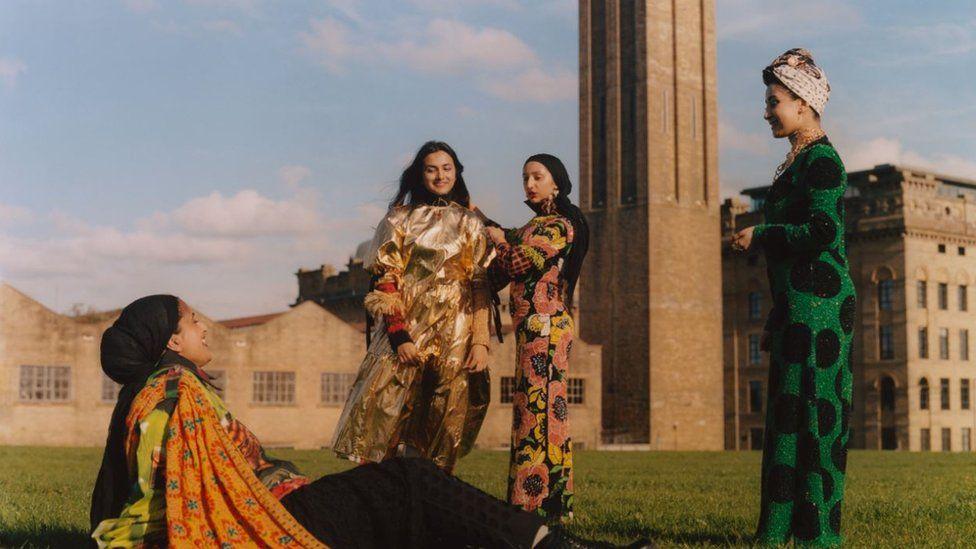 Women posing in Asian dress in front of Bradford mills