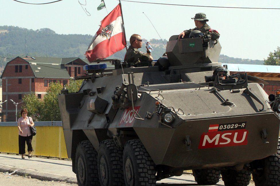 Austrian APC on patrol in Kosovo, Sept 2012 file pic
